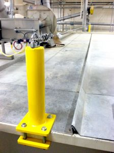 A yellow machinery lifeline. Lifeline fall protection