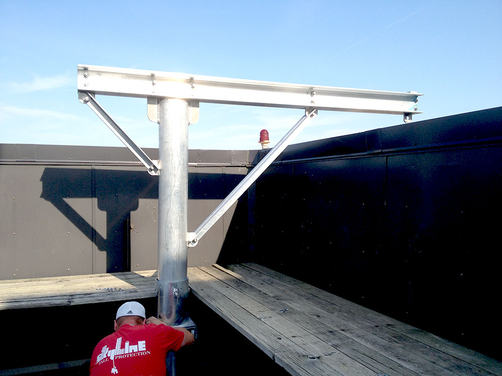 Roof davit systems being installed by Skyline Fall protection