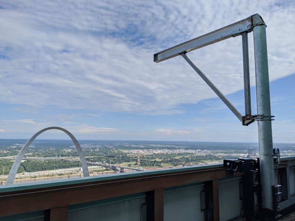 What is a Davit? A davit is an extending arm that is meant for large stages. A davit looks over a building in St. Louis.