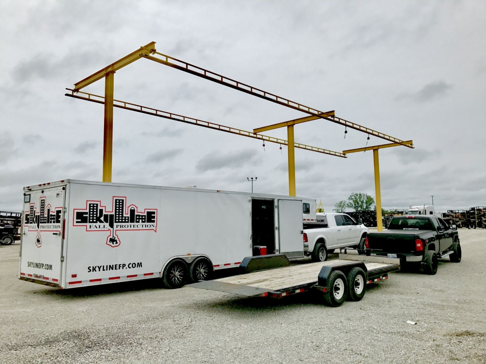 An outdoor fall protection track with the Skyline truck in the foreground. For every project, know that Skyline's fall protection certification is guaranteed.
